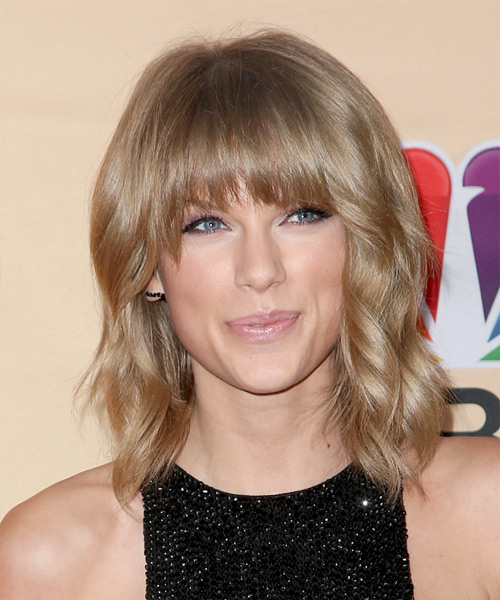 Taylor Swift Medium Wavy Casual Hairstyle with Blunt Cut Bangs - Medium Blonde (Caramel) Hair Color