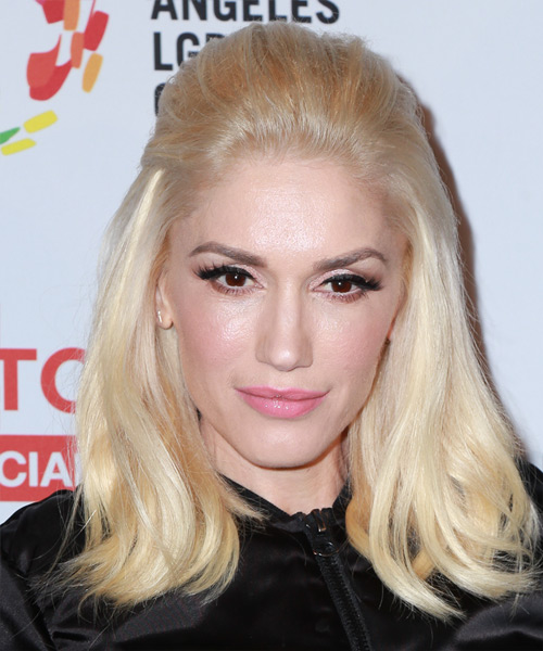 Gwen Stefani wears a half up puff hairstyle in platinum blonde