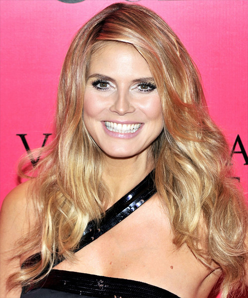 Heidi Klum Long Wavy hairstyle with Deep Side Hair