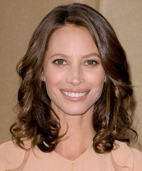 Christy Turlington Medium Wavy Casual Hairstyle - Medium Brunette (Chocolate) Hair Color