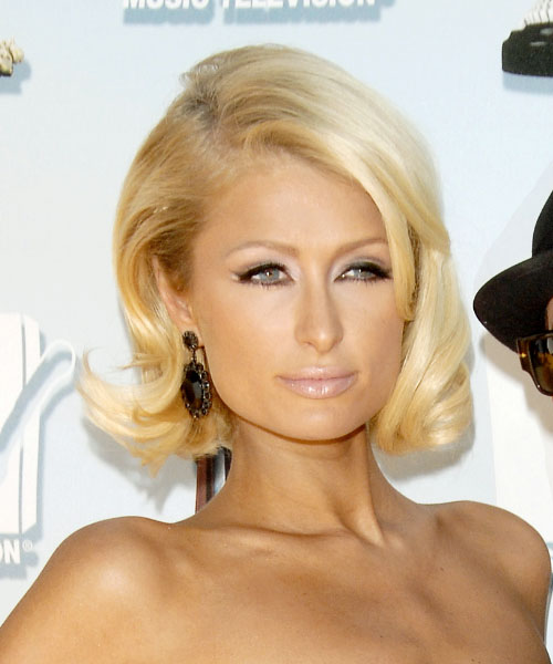 Paris Hilton Medium Wavy Formal Hairstyle with Side Swept Bangs - Light Blonde Hair Color