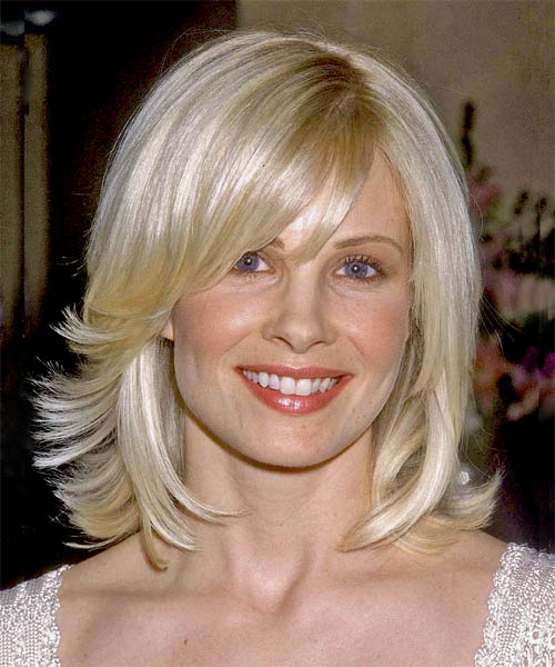 Medium Length Razor Cut Hairstyles. Monica#39;s length has been left