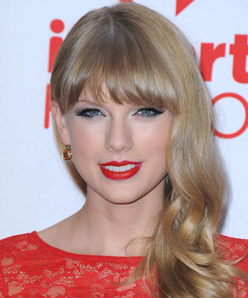 Taylor Swift Long Wavy Formal Hairstyle with Blunt Cut Bangs - Medium Blonde Hair Color