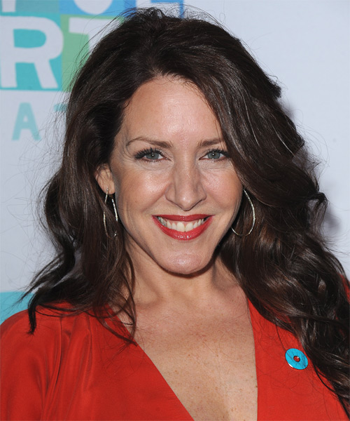 Joely Fisher Long Wavy Hairstyle