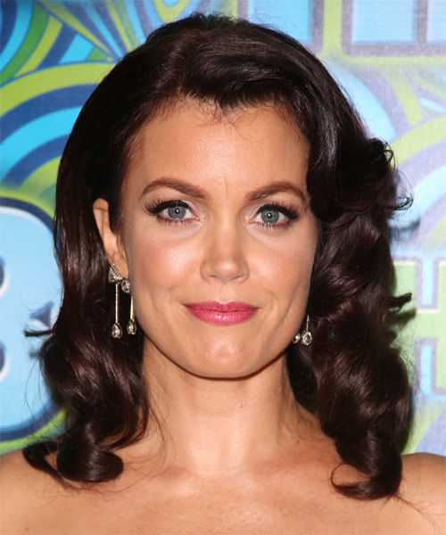 Bellamy Young Medium Wavy Formal Hairstyle