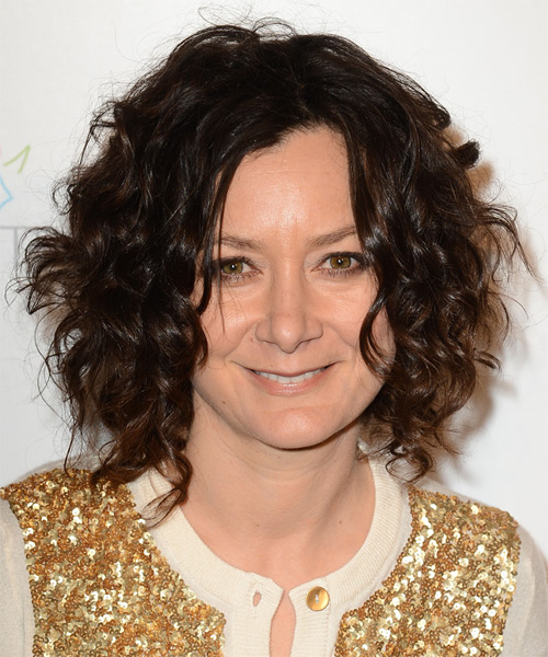 Sara Gilbert Medium Curly Casual Hairstyle - Dark Brunette Hair Color
