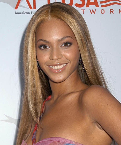 Beyonce's hair has been left below shoulder level and soft face framing