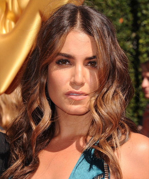 Nikki Reed long wavy hairstyle with center part