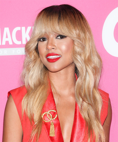 Karrueche Tran Long Wavy Casual Hairstyle with Blunt Cut Bangs - Medium Blonde Hair Color - side view