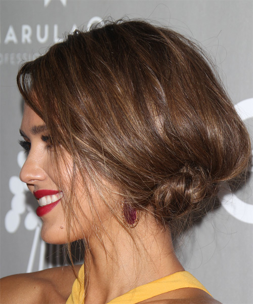 Jessica Alba wears a side bun puff hairstyle