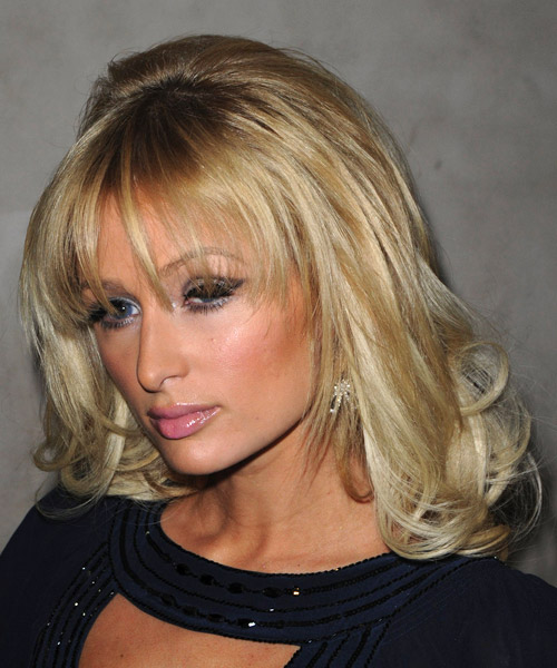 Paris Hilton Long Wavy Formal Hairstyle with Layered Bangs - Medium Blonde (Golden) Hair Color - side view