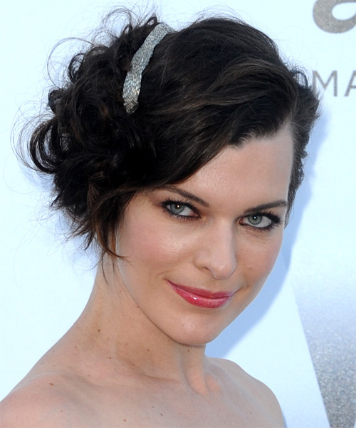 Milla Jovovich Curly Formal Updo Hairstyle with Side Swept Bangs - Dark Brunette Hair Color - side view