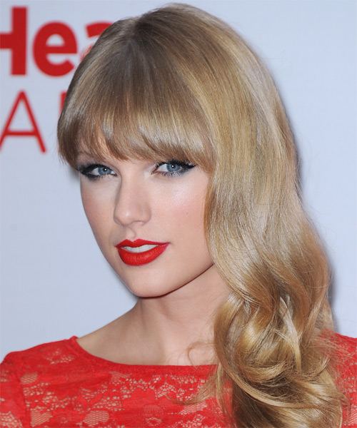 Taylor Swift Long Wavy Formal Hairstyle with Blunt Cut Bangs - Medium Blonde Hair Color - side view