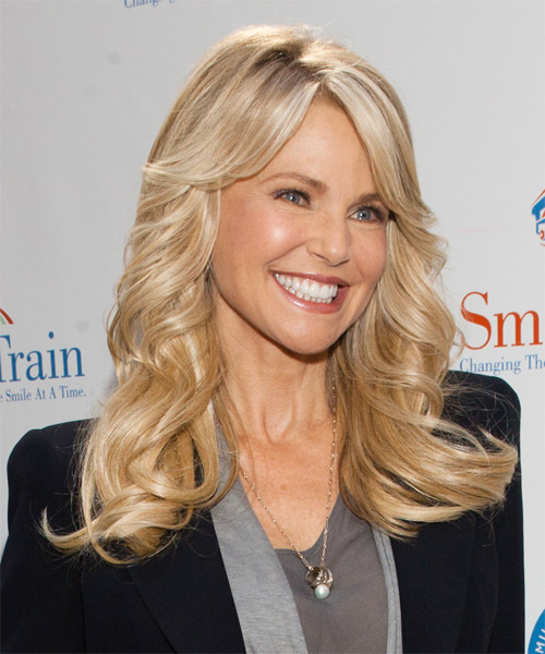 Christie Brinkley Long Wavy Formal Hairstyle with Side Swept Bangs - Light Blonde (Golden) Hair Color - side view