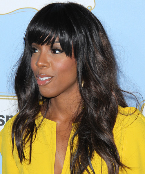 Kelly Rowland Long Wavy Casual Hairstyle with Blunt Cut Bangs - Dark Brunette Hair Color - side view