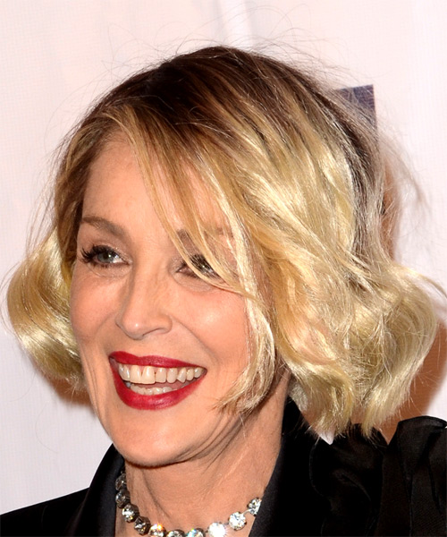 Sharon Stone Medium Wavy Casual Bob Hairstyle with Side Swept Bangs - Light Blonde Hair Color - side on view
