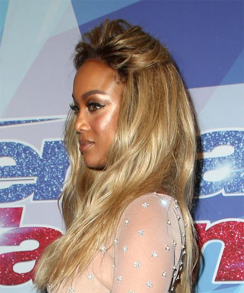 Tyra Banks Long Wavy Casual Hairstyle - Medium Blonde Hair Color - side on view