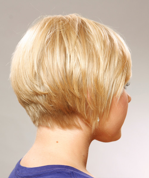 This short and sassy hairstyle is tapered into the neck to create body