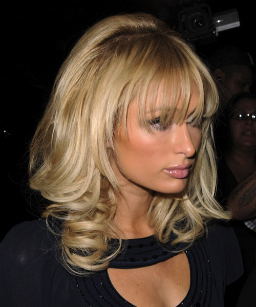 Paris Hilton Long Wavy Formal Hairstyle with Layered Bangs - Medium Blonde (Golden) Hair Color - side on view