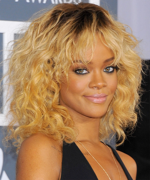 Rihanna Medium Wavy Casual Shag Hairstyle with Layered Bangs - Medium Blonde (Golden) Hair Color - side on view