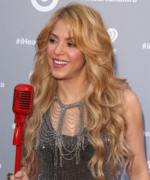 Shakira Long Wavy Casual Hairstyle - Medium Blonde (Golden) Hair Color - side on view