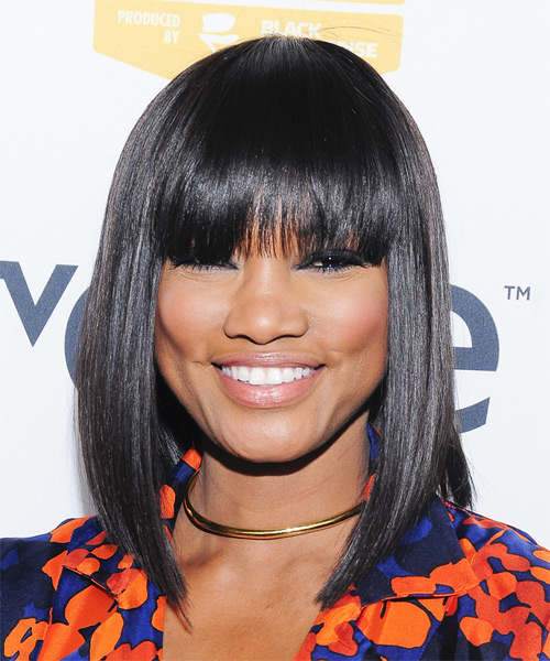 Garcelle Beauvais lob hairstyle with eye-skimming bangs