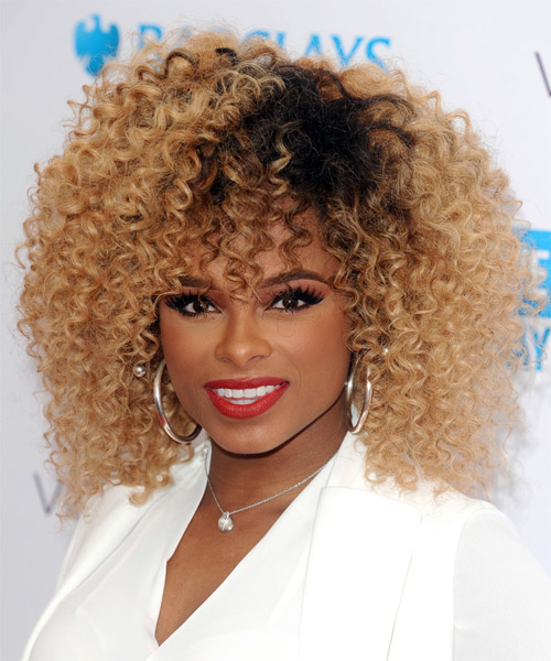 Fleur East Medium Curly Casual    Hairstyle with Layered Bangs  -  Golden Blonde Hair Color