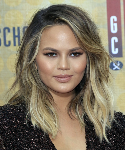 Christine Teigen Medium Wavy Layered   Blonde Bob  Haircut with Side Swept Bangs