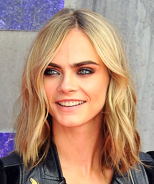 Cara Delevingne camouflages her forehead with off-center peek-a-boo part
