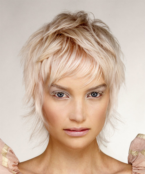 Short Wavy Light Blonde Shag Hairstyle With Layered Bangs