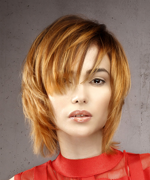 Shag layered medium length hairstyle with copper and blonde highlight bayalage