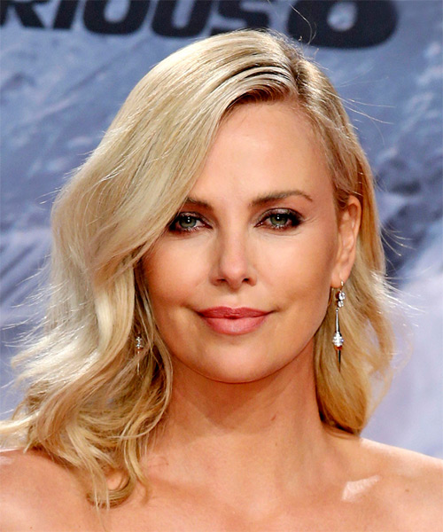 Charlize Theron lob hairstyle tucked behind the ear