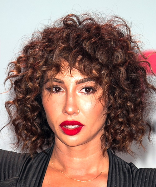 Jackie Cruz Short Curly Shag Hairstyle with Layered Bangs