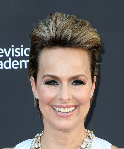 Melora Hardin wears a short puff hairstyle in blonde hair
