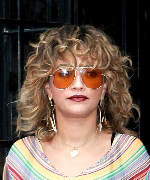 Rita Ora Medium Curly Light Brunette Shag Hairstyle with Layered Bangs