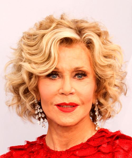 Jane Fonda Medium Curly Blonde Bob Wash And Go Haircut with Side Swept Bangs