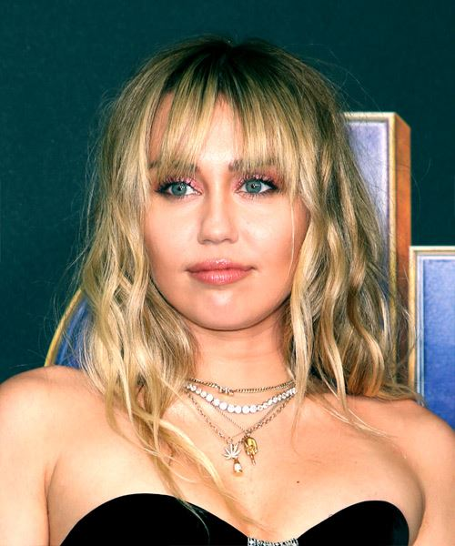 Miley Cyrus Medium Wavy Casual    Hairstyle with Blunt Cut Bangs  -  Blonde Hair Color
