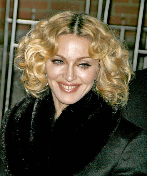 Madonna Medium Curly Casual    Hairstyle   -  Golden Blonde Hair Color with Light Blonde Highlights