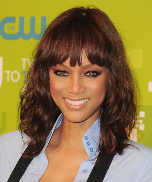 Tyra Banks Medium Wavy Casual    Hairstyle with Blunt Cut Bangs  - Dark Mahogany Red Hair Color