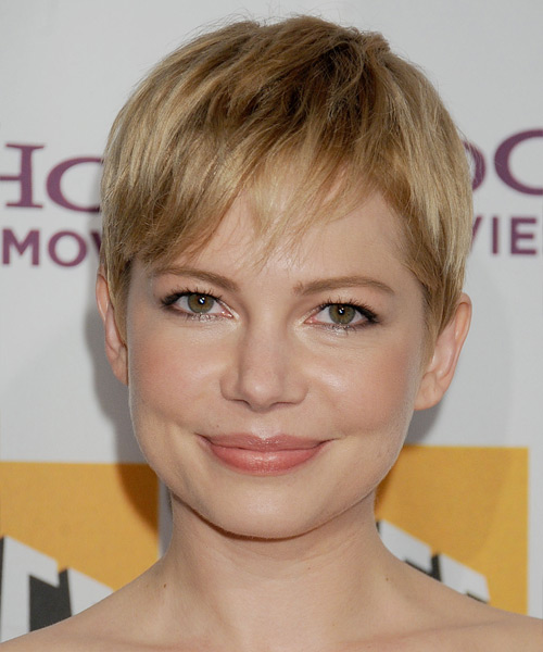 Michelle Williams   Layered  Dark Golden Blonde Pixie  Cut with Side Swept Bangs  and Light Blonde Highlights