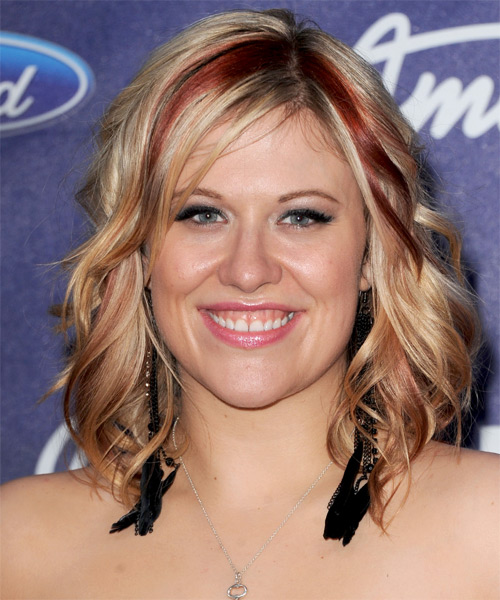 Erika Van Pelt  Medium Wavy    Blonde   Hairstyle with Side Swept Bangs  and  Red Highlights
