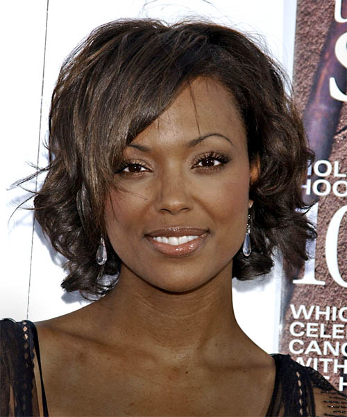Aisha Tyler Medium Wavy Formal   Hairstyle