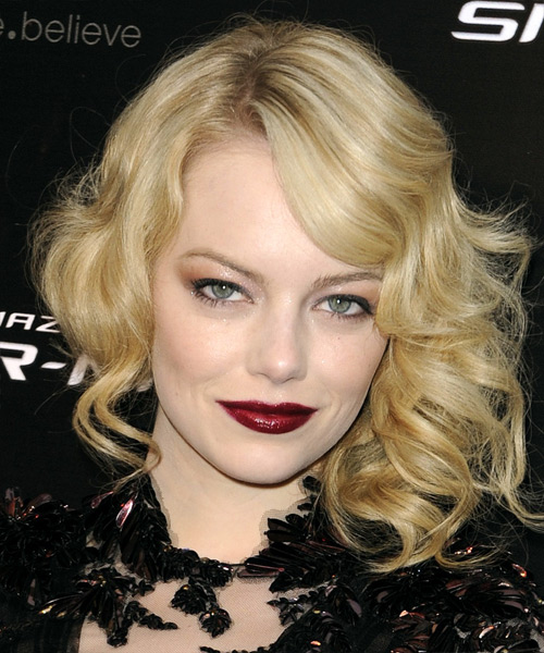 Emma Stone Medium Wavy    Golden Blonde   Hairstyle with Side Swept Bangs  and Light Blonde Highlights