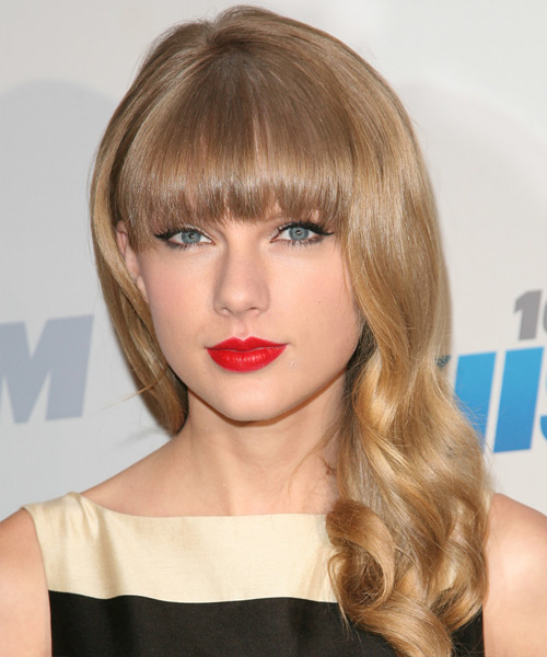 Taylor Swift Long Wavy Casual    Hairstyle with Blunt Cut Bangs  -  Honey Blonde Hair Color