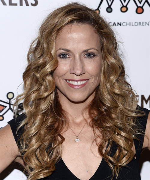 Sheryl Crow Long Curly   Dark Blonde   Hairstyle   with Light Blonde Highlights