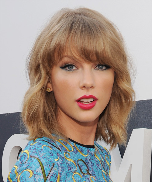 Taylor Swift Medium Wavy Casual Hairstyle With Blunt Cut Bangs Dark Copper Blonde Hair Color