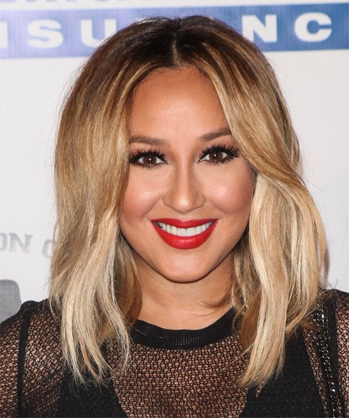 Adrienne Bailon medium straight hairstyle with center part