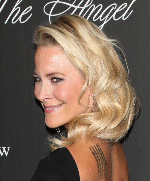 Brittany Daniel Long Wavy   Light Golden Blonde   Hairstyle   - Side on View
