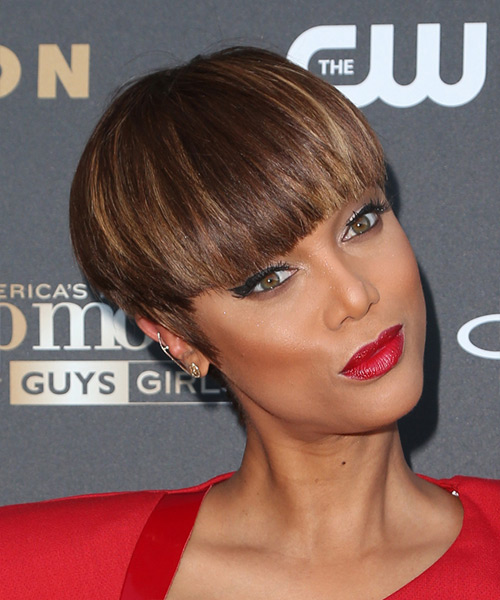 Tyra Banks Short Straight Formal    Hairstyle with Blunt Cut Bangs  -  Chocolate Brunette Hair Color with Dark Blonde Highlights - Side on View
