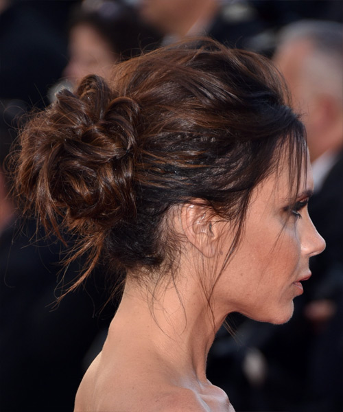 Victoria Beckham wears a formal up-do puff hairstyle